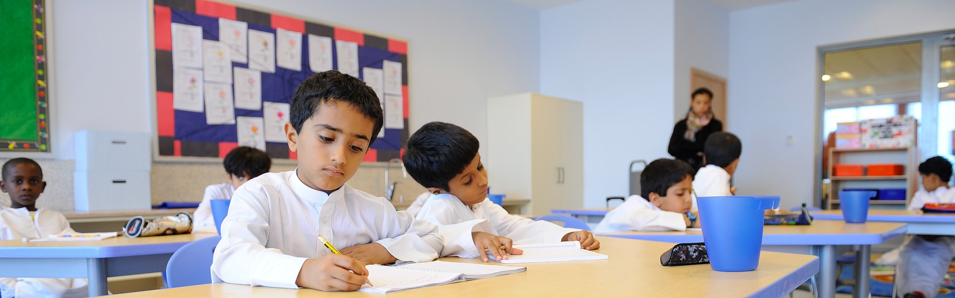 Young kids studying in a classroom in Abu Dhabi