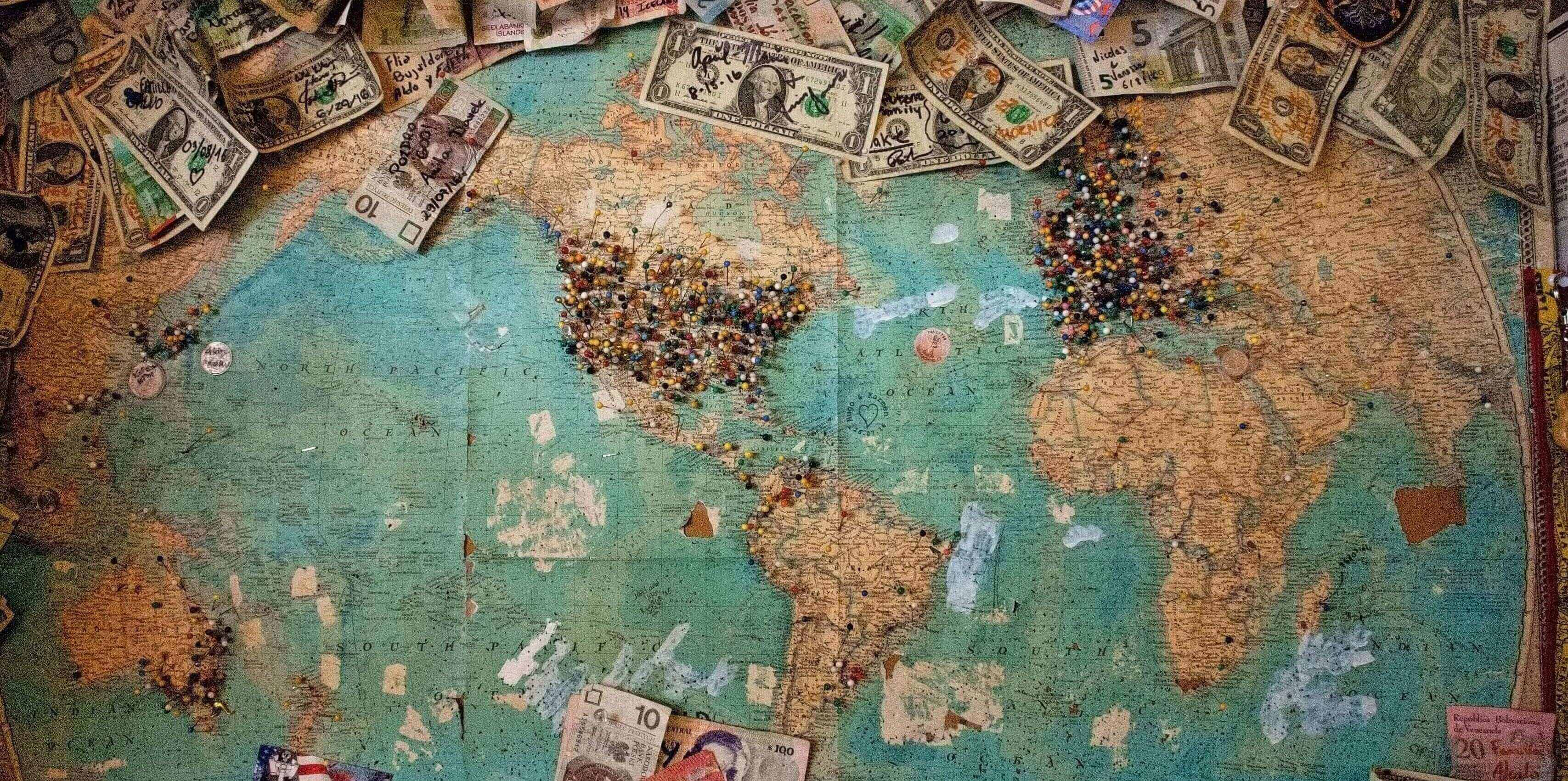 map covered in money and pins