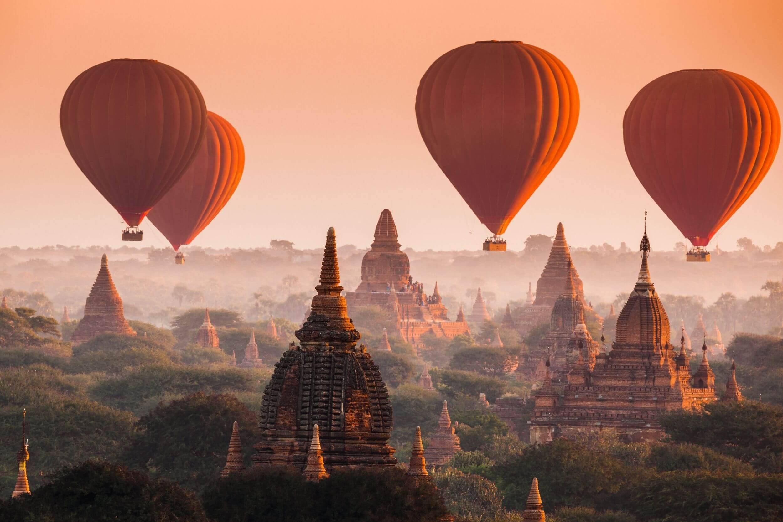 Bagan, Myanmar with hot air balloons floating overhead