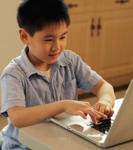 Chinese child on laptop